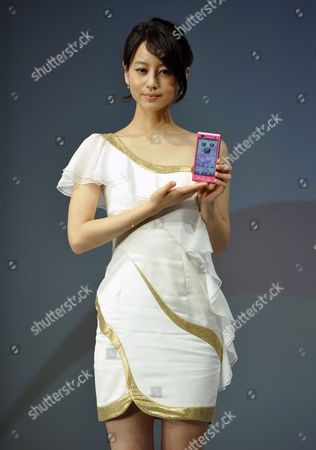 Japanese Actress Maki Horikita Poses As She Holds a Smartphone Featuring Characters From Walt Disney at a Press Event in Tokyo Japan 01 February 2012 Ntt Docomo Said It Will Release Two Smartphones Featuring Characters From Walt Disney Co in Cooperation with a Local Unit of the Us Entertainment Giant Both Handsets Will Run Google Inc 'S Android Operating System and Are Expected to Be on Sale at a Prices Ranging From 200 to 300 Euros Japan Tokyo