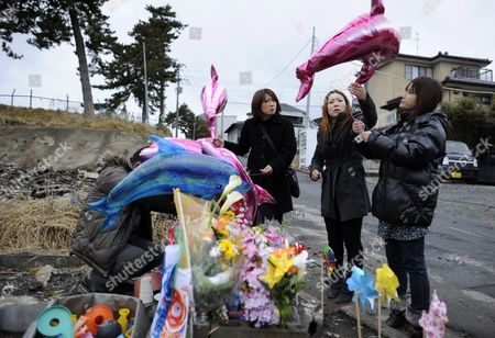 Mothers of Deceased Chidren Mika Sato (r) Etsuko Saijo (c) and Megumi Sasaki (l) Prepare Balloons at the Site where Their 6-year-old Daughters Were Found in a Bus at Tsunami-devastated City of Ishinomaki Miyagi Prefecture Japan 10 March 2012 the Eve of One Year After the Earthquake and Tsunami That Killed Almost 20 000 People Parents of Four Children Killed when Their School Bus was Swallowed by the 11 March Tsunami Filed a Lawsuit Against the Hiyori Kindergarten in Ishinomaki the Complaint Filed Said the School Bus Left the Kindergarten Just After the Massive Earthquake to Bring the Children Back to Their Parents' Homes Along the Coastline Despite the Fact That a Tsunami Warning was Already Issued They Accuse the Kindergarten of Failing to Collect Appropriate Emergency and Safety Information As the Children Were Safe Staying at the Kindergarten Located on High Ground Japan Ishinomaki