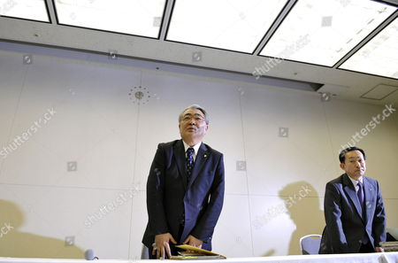 Toshio Nishizawa (l) President of Tokyo Electric Power Co (tepco) Stands After Giving a Press Conference in Tokyo Japan 13 February 2012 Tepco Said It Expects Losses For the Year to March 31 to Reach 8 9 Billion Usd As Compensation and Clean-up Costs Increased After the Fukushima Nuclear Disaster Japan Tokyo