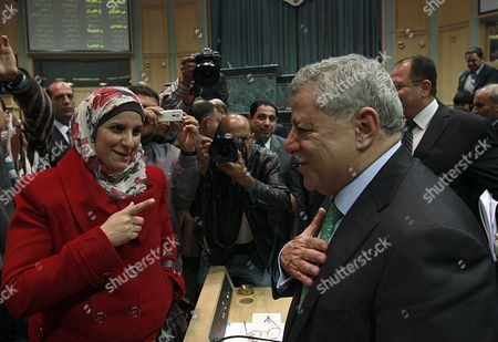 Jordanian Prime Minister Awn Khasawneh (r) Accepts Congratulations From a Female Member of Parliament Rudaida Otti (l) After Winning the Vote of a Confidence at the Lower House of Parliament in Amman Jordan 01 December 2011 Reports State That Jordans New Government Won a Confidence Vote on an 89-25 Vote in the Countrys Lower House of Parliament on 01 December 2011 After Four Days of Debate Jordan Amman