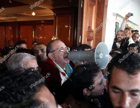 Libya's Interim Prime Minister Abdurrahim El-keib (c) Uses a Loudspeaker to Address Libyan Berber People (also Called Amazigh) Protesting Outside His Office in Tripoli Libya 27 November 2011 According to Media Reports Hundreds of Libya's Main Ethnic Minority Groups the Bebers (amazigh Which Means Free Men) Protested on 27 November to Ask For a Better Representation in the New Governing Bodies of the Country Libyan Arab Jamahiriya Tripoli