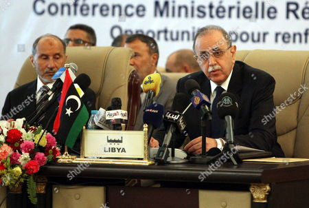 Libyan Interim Prime Minister Abdel-rahim Al-keeb (r) and Libya's National Transitional Council (ntc) Chairman Mustafa Abdul Jalil (l) Attend the Opening of Regional Ministerial Conference on Border Security Entitled 'Opportunities For Enhanced Operational Cooperation' in Tripoli Libya 11 March 2012 According to Local Media Reports Defence and Interior Ministries Officials From Algeria Niger Mali and Other Countries Sharing Border with Libya Started on 11 March a Two-day Meeting on Security Issues and Cooperation Libyan Arab Jamahiriya Tripoli