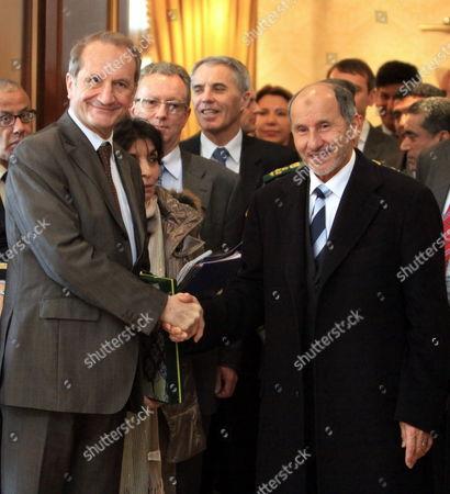 Chairman of Libya's National Transitional Council (tnc) Mustafa Abdel Jalil (r) Shakes Hands with French Defence Minister Gerard Longuet (l) in Tripoli Libya 25 February 2012 Longuet is on an Official Visit to Libya Libyan Arab Jamahiriya Tripoli