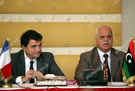 Libyan Commerce Minister Tahir Cherks (r) Gestures As He Speaks Next to French State Minister For Foreign Trade Pierre Lellouche During Conference of the Libyan and French Businessmen in Tripoli Libya 20 October 2011 Lellouche is on a Day Visit in Tripoli and Came with a Delegation of French Businessman Lellouche Announced New Negotiations Between Airbus and Libyan Authorities Regarding the Delivery of 11 Planes Ordered in 2007 by the Two Public Companies Afriqiya Et Libyan Airlines Libyan Arab Jamahiriya Tripoli