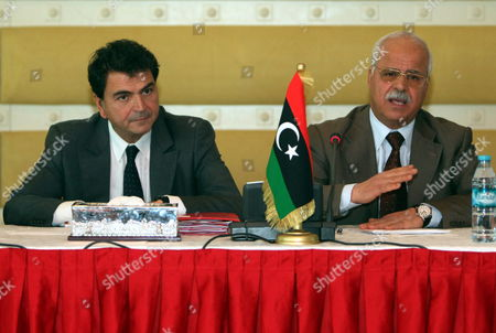 Libyan Commerce Minister Tahir Cherks (r) Gestures Next to French State Minister For Foreign Trade Pierre Lellouche During a Conference of the Libyan and French Businessmen in Tripoli Libya 20 October 2011 Lellouche is on a Day Visit in Tripoli and Came with a Delegation of French Businessman Lellouche Announced New Negotiations Between Airbus and Libyan Authorities Regarding the Delivery of 11 Planes Ordered in 2007 by the Two Public Companies Afriqiya Et Libyan Airlines Libyan Arab Jamahiriya Tripoli