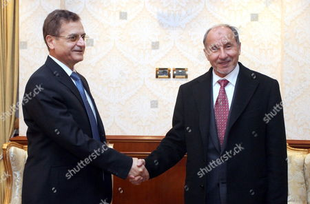 Libya's National Transitional Council (ntc) Chairman Mustafa Abdul Jalil (r) Shakes Hands with Lebanese Foreign Minister Adnan Mansour (l) in Tripoli Libya 12 January 2012 Media Reports Stated Mansour Arrived in Tripoli on 11 January in the First Visit by a Lebanese Top Diplomat in More Than 30 Years He is Leading a Lebanese Delegation to Discuss with Libyan Officials the Case of Disappearance of Shiite Imam Moussa Al-sadr who Went Missing with Two Aides While Visiting Libya in 1978 Libyan Arab Jamahiriya Tripoli