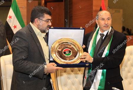 Chairman of Libya's National Transitional Council Mustafa Abdel Jalil (r) Stands with the Head of the Syrian Delegation Emad Al-deen Rasheed who is a Member in the Syrian National Council (snc) in Tripoli Libya 28 February 2012 Libyan Arab Jamahiriya Tripoli