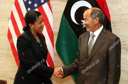 Stock Photo of Us Ambassador to the United Nations Susan Rice (l) Shakes Hands with Chairman of Libya's National Transitional Council (tnc) Mustafa Abdel Jalil (r) in Tripoli Libya 21 November 2011 Rice Visit Comes a Day After Libyan Fighters Have Captured Former Intelligence Chief Abdullah Al-senussi on 19 November 2011 in the Southwestern Part of the Country One Day After the Fugitive Son of Slain Leader Muamar Gaddafi was Arrested Al-senussi who Has Been Intelligence Chief Until Gaddafi's Final Days was Arrested in His Sister's House Near the Southwestern City of Sabha Said Abdul Hafiz Ghoga Vice Chairman of the Ruling National Transitional Council Libyan Arab Jamahiriya Tripoli