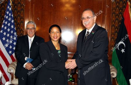 Us Ambassador to the United Nations Susan Rice (c) Shakes Hands with Libyan Interim Prime Minister Abdel-rahim Al-keeb (r) During a Press Conference in Tripoli Libya 21 November 2011 Rice Visit Comes a Day After Libyan Fighters Have Captured Former Intelligence Chief Abdullah Al-senussi on 19 November 2011 in the Southwestern Part of the Country One Day After the Fugitive Son of Slain Leader Muamar Gaddafi was Arrested Al-senussi who Has Been Intelligence Chief Until Gaddafi's Final Days was Arrested in His Sister's House Near the Southwestern City of Sabha Said Abdul Hafiz Ghoga Vice Chairman of the Ruling National Transitional Council Libyan Arab Jamahiriya Tripoli
