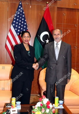 Us Ambassador to the United Nations Susan Rice (l) Shakes Hands with Chairman of Libya's National Transitional Council (tnc) Mustafa Abdel Jalil (r) in Tripoli Libya 21 November 2011 Rice Visit Comes a Day After Libyan Fighters Have Captured Former Intelligence Chief Abdullah Al-senussi on 20 November 2011 in the Southwestern Part of the Country on 19 November the Fugitive Son of Slain Leader Muamar Gaddafi was Arrested Al-senussi who Has Been Intelligence Chief Until Gaddafi's Final Days was Arrested in His Sister's House Near the Southwestern City of Sabha Said Abdul Hafiz Ghoga Vice Chairman of the Ruling National Transitional Council Libyan Arab Jamahiriya Tripoli