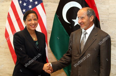 Us Ambassador to the United Nations Susan Rice (l) Shakes Hands with Chairman of Libya's National Transitional Council (tnc) Mustafa Abdel Jalil (r) in Tripoli Libya 21 November 2011 Rice Visit Comes a Day After Libyan Fighters Have Captured Former Intelligence Chief Abdullah Al-senussi on 19 November 2011 in the Southwestern Part of the Country One Day After the Fugitive Son of Slain Leader Muamar Gaddafi was Arrested Al-senussi who Has Been Intelligence Chief Until Gaddafi's Final Days was Arrested in His Sister's House Near the Southwestern City of Sabha Said Abdul Hafiz Ghoga Vice Chairman of the Ruling National Transitional Council Libyan Arab Jamahiriya Tripoli