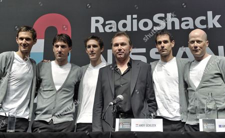 Stock Picture of (l-r) Luxembourg Frank Schleck Swiss Fabian Cancellara Luxembourg Andy Schleck Belgian Johan Bruyneel German Andreas Kloden Us Chris Horner Pose During the Press Presentation of Radioshack Nissan Trek Cycling Team in Esch-belval Luxembourg 06 January 2012 Luxembourg Esch - Belval