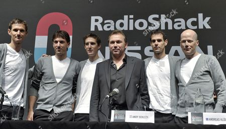 (l-r) Luxembourg Frank Schleck Swiss Fabian Cancellara Luxembourg Andy Schleck Belgian Johan Bruyneel German Andreas Kloden Us Chris Horner Pose During the Press Presentation of Radioshack Nissan Trek Cycling Team in Esch-belval Luxembourg 06 January 2012 Luxembourg Esch - Belval