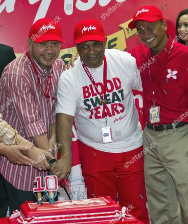 Airasia Group Ceo Tony Fernandes (c) Airasia Group Deputy Ceo Kamarudin Meranun ((l) and Airasia -x Ceo Azran Osman-rani Cut the Cake During the Airasia's 10th Anniversary at Low Cost Carrier Terminal (lcct) in Sepang Outside Kuala Lumpur Malaysia 08 December 2011 Airasia Grew From Two Aircraft and Three Destinations in December 2001 to 107 Aircraft with Over 80 Destinations Across 24 Countries Malaysia Sepang