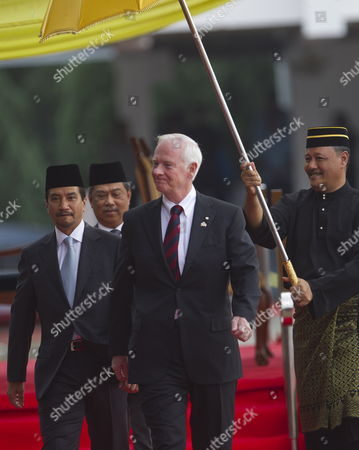 Canada Governor-general David Johnston (c) Walks with Malaysian King Sultan Mizan Zainal Abidin (l) Followed by Malaysian Deputy Prime Minister Muhyiddin Yassin (back) During a Welcoming Ceremony at Parliament Square in Kuala Lumpur Malaysia 14 November 2010 Canada's Governor-general David Johnston is in Malaysia For a Four-day State Visit to Further Enhance the Existing Bilateral Relations Between the Two Countries Malaysia Kuala Lumpur