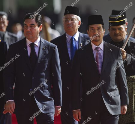 Visiting Turkmenistan President Gurbanguly Berdimuhamedov (l) Walks with Malaysian King Sultan Mizan Zainal Abidin (r) Followed by Malaysian Prime Minister Najib Razak (c) During a Welcoming Ceremony at Parliament Square in Kuala Lumpur Malaysia 07 December 2011 Berdimuhamedov is on a Three-day State Visit to Malaysia to Enhance Bilateral Relations Between the Two Countries Malaysia Kuala Lumpur