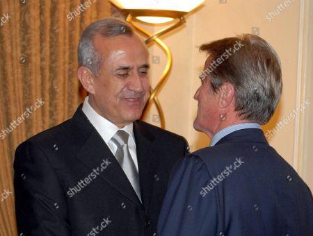 French Minister of Foreign Affairs Bernard Kouchner congratulates President Michel Suleiman.