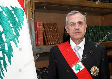 Newly elected Lebanese President Michel Suleiman poses at the Presidential Palace in Baabda