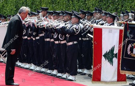 Newly elected Lebanese President Michel Suleiman reviews the honour guard upon his arrival to the Presidential Palace in Baabda