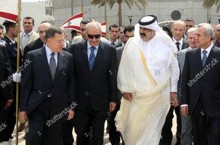 Newly-elected Lebanese President Michel Suleiman, right, Lebanese Parliament speaker Nabih Berri, centre left, and outgoing Lebanese Prime Minister Fuad Saniora, left
