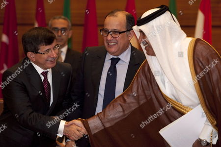 Stock Image of Turkish Foreign Secretary Ahmet Davutoglu (l) Shakes Hands with Qatar Foreign Secretary and Prime Minister Sheikh Hamad Bin Jassim with the Presence of Their Moroccan Counterpart Taieb Fassi Fihri (c) During the Meeting of the Arab League in Rabat Morocco on 16 November 2011 the Members Discuss Today the Problematic of Syria and Its Permanence in the League the Syrian Government Decided Late 15 November That It Will not Take Part in the 4th Session of the Arab-turkish Forum Nor the Arab League Ministerial Meetings Scheduled to Convene in the Moroccan Capital Rabat on 16 November the State-run Syrian News Agency (sana) Reported Morocco Rabat