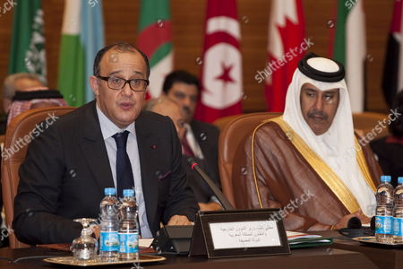 Morrocan Foreign Secretary Taieb Fassi Fihri (l) with His Counterpart From Qatar Sheikh Hamad Bin Jassim Al-thani Speaks During the Meeting of the Arab League in Rabat Morocco on 16 November 2011 the Members Discuss Today the Problematic of Syria and Its Permanence in the League the Syrian Government Decided Late 15 November That It Will not Take Part in the 4th Session of the Arab-turkish Forum Nor the Arab League Ministerial Meetings Scheduled to Convene in the Moroccan Capital Rabat on 16 November the State-run Syrian News Agency (sana) Reported Morocco Rabat