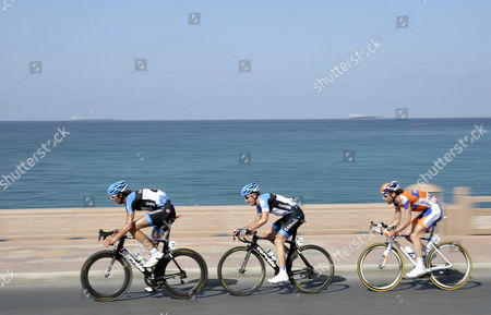 Belgian Rider Johan Van Summeren (l) of the Garmin Barracuda Team His Us Teammate Christian Vandevelde (c) and Dutch Rider Laurens Ten Dam (r) of the Rabobank Cycling Team in Action During the 6th Stage of the Tour of Oman Cycling Race Between Al Khawd and Matrah Corniche Oman 19 February 2012 Oman Matrah