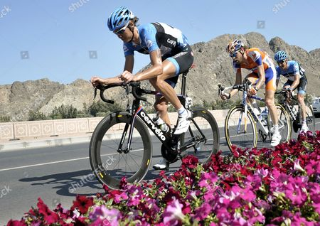 Belgian Rider Johan Van Summeren (l) of the Garmin Barracuda Team His Us Teammate Christian Vandevelde (r) and Dutch Rider Laurens Ten Dam (c) of the Rabobank Cycling Team in Action During the 6th Stage of the Tour of Oman Cycling Race Between Al Khawd and Matrah Corniche Oman 19 February 2012 Oman Matrah