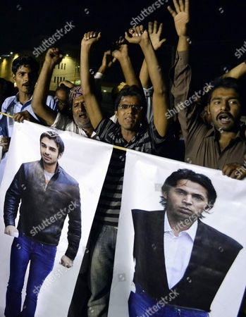Stock Photo of People Carry Posters of Pakistani Cricketers Salman Butt and Mohammad Asif who Were Sentenced by the London's Southwark Crown Court to Jail For Their Role in a Fixing Affair Around a Test Match Against England Last Year During a Protest in Multan Pakistan 03 November 2011 the Suspects Were Charged After an Undercover Reporter From the Now Defunct News of the World Paper Recorded Mazhar Majeed the Agent of the Players As Saying He Could Arrange Fixing Schemes with Pakistan Players Pakistan Multan