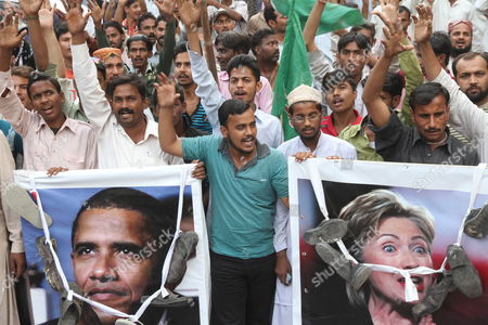 People Carry Posters Featuring Us President Barack Obama (l) and Us Secretary of State Hillary Clinton During a Protest Against the Nato Airstrikes on Pakistani Military Checkposts in Mohmand Tribal Agency in Karachi Pakistan 01 December 2011 Pakistan Said on 29 November It Would Boycott an International Conference on Afghanistan in Bonn Germany Next Month in Protest of the Nato Attack on Pakistani Army Posts That Killed 24 Soldiers and Sparked Anti-western Protests in the Country the Government Made the Decision at a Cabinet Meeting in the Eastern City of Lahore Chaired by Prime Minister Yousuf Raza Gilani Pakistan Karachi