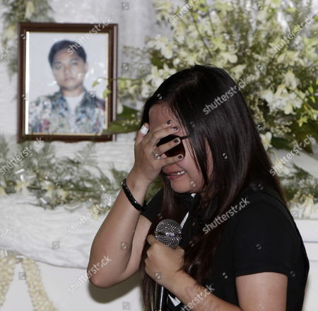 Filipino Singer/actress Charice Pempengco Weeps While Paying Her Last Respect to Her Father Ricky Pempengco Casket During a Burial Ceremony Muntinlupa City South of Manila Philippines 05 November 2011 the Father of the 18-year-old Glee Star was Laid to Rest Five Days After He was Stabbed to Death by Construction Worker Angel Capili Jr Hundreds of Fans Converged on the Cemetery to Get a Glimpse of the Singer Officials Said Philippines Manila