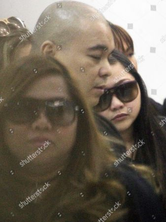 Filipino Singer and Actress Charice Pempengco (r) with Mother Raquel (l) Arrive to Witness the Surrender of His Father's Killer Inside a Military Camp in Quezon City East of Manila Philippines 03 November 2011 the Prime Suspect in the Killing of International Singer Charices Father Ricky Pempengco Surrendered to Authorities the Suspect a Construction Worker was the Subject of a Manhunt After Witnesses Saw Him Fatally Stab Ricky Pempengco Before Midnight on 31 October 2011 in the Town of San Pedro Laguna Province Philippines Manila