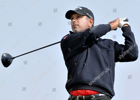 Jeev Milkha Singh of India Watches His Shot During the Third Round of the Commercialbank Qatar Masters Golf Tournament at the Doha Golf Club in Doha Qatar 04 February 2012 Qatar Doha
