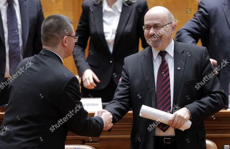 Designated Romanian Prime Minister Mihai Razvan Ungureanu (l) is Congratulated by His Vice-premier Marko Bella (r) of Democrat Union of Ethnic Hungarians of Romania Party (udmr) After the Parliament Has Approved the Government in Bucharest Romania 09 February 2012 Ungureanu Former Head of Romanian Foreign Intelligence Service (sie) Named His Cabinet on 08 February Replacing Almost All Ruling Party Ministers in an Attempt to Make a Clean Break From His Predecessor Emil Boc who Quit Due to a Series of Protests Against Austerity Measures Epa/robert Ghement Romania Bucharest