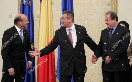Romanian New Prime Minister Mihai Razvan Ungureanu (c) is Congratulated by Romania's Presidnet Traian Basescu (l) and President of the Senate Vasile Blaga (r) During the Swearing in Ceremony at the Presidential Palace in Bucharest Romania 09 February 2012 Mihai Razvan Ungureanu Former Head of Romanian Foreign Intelligence Service (sie) Named His Cabinet on 08 February Replacing Almost All Ruling Party Ministers in an Attempt to Make a Clean Break From His Predecessor Emil Boc who Quit Due to a Series of Protests Against Austerity Measures Romania Bucharest