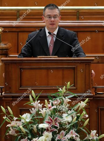 Designated Romanian Prime Minister Mihai Razvan Ungureanu Delivers a Speech at the Parliament in Bucharest Romania 09 February 2012 Ungureanu Former Head of Romanian Foreign Intelligence Service (sie) Named His Cabinet on 08 February Replacing Almost All Ruling Party Ministers in an Attempt to Make a Clean Break From His Predecessor Emil Boc who Quit Due to a Series of Protests Against Austerity Measures Romania Bucharest