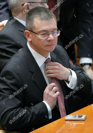 Designated Romanian Prime Minister Mihai Razvan Ungureanu Adjusts His Tie Prior to a Confidence Vote at the Parliament in Bucharest Romania 09 February 2012 Ungureanu Former Head of Romanian Foreign Intelligence Service (sie) Named His Cabinet on 08 February Replacing Almost All Ruling Party Ministers in an Attempt to Make a Clean Break From His Predecessor Emil Boc who Quit Due to a Series of Protests Against Austerity Measures Romania Bucharest