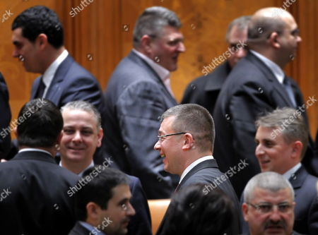 New Romanian Prime Minister Mihai Razvan Ungureanu (c) Surrounded by His Ministers Laughs After a Confidence Vote at the Parliament in Bucharest Romania 09 February 2012 Ungureanu Former Head of Romanian Foreign Intelligence Service (sie) Named His Cabinet on 08 February Replacing Almost All Ruling Party Ministers in an Attempt to Make a Clean Break From His Predecessor Emil Boc who Quit Due to a Series of Protests Against Austerity Measures Epa/robert Ghement Romania Bucharest