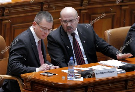 Designated Romanian Prime Minister Mihai Razvan Ungureanu Chats with Proposed Vice-premier Marko Bella (r) of Democrat Union of Ethnic Hungarians of Romania Party (udmr) Prior to a Confidence Vote at the Parliament in Bucharest Romania 09 February 2012 Ungureanu Former Head of Romanian Foreign Intelligence Service (sie) Named His Cabinet on 08 February Replacing Almost All Ruling Party Ministers in an Attempt to Make a Clean Break From His Predecessor Emil Boc who Quit Due to a Series of Protests Against Austerity Measures Romania Bucharest