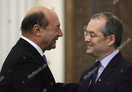 Romanian President Traian Basescu (l) Shares a Word with Former Prime Minister Emil Boc (r) Shortly After the New Ungureanu Cabinet Swear in at Presidential Palace in Bucharest Romania 09 February 2012 Mihai Razvan Ungureanu Former Head of Romanian Foreign Intelligence Service (sie) Named His Cabinet on 08 February Replacing Almost All Ruling Party Ministers in an Attempt to Make a Clean Break From His Predecessor Emil Boc who Quit Due to a Series of Protests Against Austerity Measures Romania Bucharest