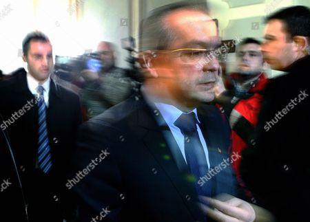 Romanian Prime Minister Emil Boc Looks Down While Leaving Democrat-liberal Party (pdl) Headquarters Shortly After He Resigned in Bucharest Romania 06 February 2012 Emil Boc Announced During the Last Government Working Session That He and His Entire Cabinet Team is Resigning Romania Bucharest