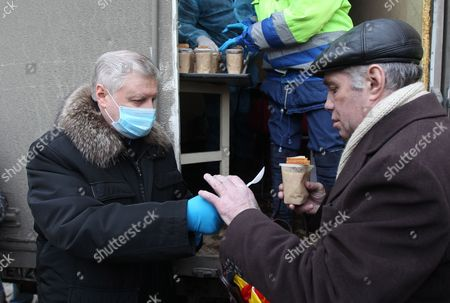 Presidential Candidate From 'A Just Russia' Party Sergei Mironov (l) Attends a Food Distribution For Homeless People in Downtown of Moscow Russia 29 February 2012 Russia's Presidential Elections Are Scheduled on 04 March Russia's Presidential Elections Are Scheduled on 04 March Russian Federation Moscow