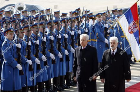 Italian Prime Minister Mario Monti (l) Reviews Guards of Honor with His Serbian Counterpart Mirko Cvetkovic (r) Upon His Arrival in Belgrade Serbia 08 March 2012 the Second Political and Business Summit Serbia-italy Takes Place in Belgrade with the Participation of Serbian President Boris Tadic and the Two Countries' Prime Ministers Mirko Cvetkovic and Mario Monti Serbia and Montenegro Belgrade