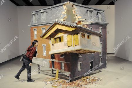 Installation of a house titled Fallen Star(2008) by artist Do Ho Suh