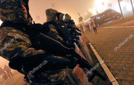 Stock Picture of Policemen Stand Guard Before the Concert of Bosnian Pop Star Dino Merlin in Belgrade Serbia 25 November 2011 This was Dino Merlin's First Concert in Belgrade Since the Conflict in Former Yugoslavia Erupted Heavy Security Measures Were Put in Place After Serbian Ultra-nationalists Called on the Serbian Audience to Boycott the Event Serbia and Montenegro Belgrade