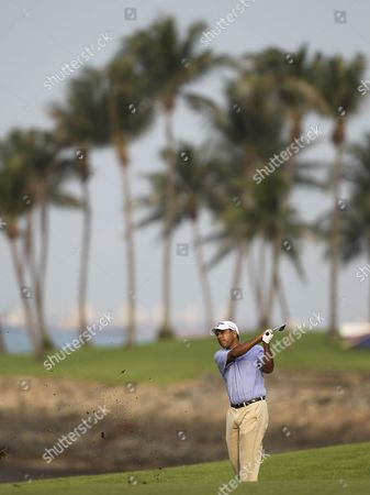 Jeev Milkha Singh of India Takes a Shot From the Fairway of the Seventh Hole During the Second Round of the Barclays Singapore Open at the Sentosa Golf Club in Singapore 11 November 2011 Singapore Singapore