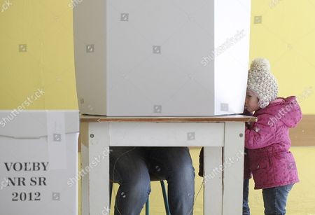 A Girl Watches Her Mother Preparing Her Ballot at a Polling Station in Bratislava Slovakia During Early Elections on 10 March 2012 Slovakian Parliamentary Elections Began Saturday in a Climate of Public Anger Over Corruption Allegations Against Politicians Media Reports State That Opinion Polls See Former Prime Minister Robert Fico's Smer Social Democrats Poised to Heavily Defeat the Center-right Sdku Party's Outgoing Prime Minister Iveta Radicova Slovakia (slovak Republic) Bratislava