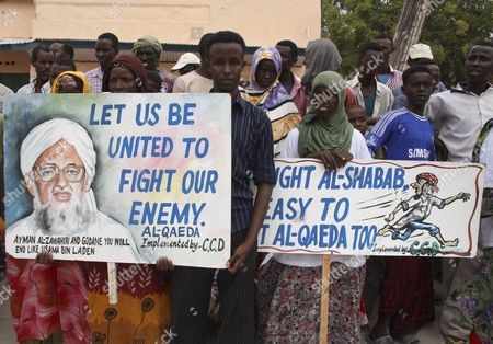 Stock Photo of Somali Demonstrators Hold Placards to Protest Against the Country's Islamist Insurgents Al-shabab and Al-qaeda During a Demonstration in Mogadishu Somalia 15 February 2012 in a Video Released on 09 February by the Site Intelligence Group Al-shabab Leader Ahmed Abdi Godane Also Known As Mukhtar Abu Zubair Said the Group Pledged Obedience to Al-qaeda Chief Ayman Al-zawahiri and the Two Groups Have Merged Somalia Mogadishu