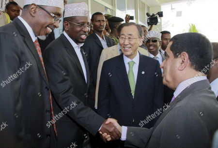 Un Secretary-general Ban Ki-moon (2-r) Smiles As the President of Somalia Sheikh Sharif Ahmed (2-l) Shakes Hands with the President of the Un General Assembly Nassir Abdulaziz Al-nasser (r) at the Presidential Palace in Mogadishu Somalia 09 December 2011 Ban Announced That the Un Office For Somalia Will Relocate to Mogadishu From Kenya Next Year a Move Seen As a Sign of Recent Security Gains in Mogadishu Somalia Mogadishu