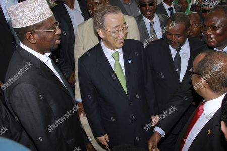 Un Secretary-general Ban Ki-moon (c) is Welcomed by the President of Somalia Sheikh Sharif Ahmed (l) at the Presidential Palace Upon His Arrival in Mogadishu Somalia 09 December 2011 Ban Announced That the Un Office For Somalia Will Relocate to Mogadishu From Kenya Next Year a Move Seen As a Sign of Recent Security Gains in Mogadishu Somalia Mogadishu